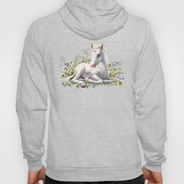 Baby unicorn lies in flowers Hoody