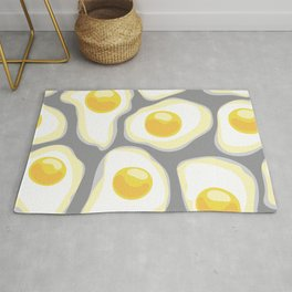 fried eggs on gray background Rug