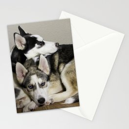 Tan and White Husky, and Black and White Siberian Husky with Blue Eyes Snuggling Stationery Cards