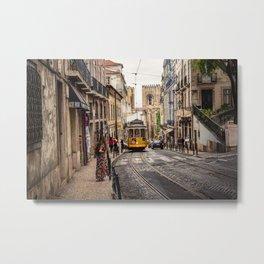Tram 28 transports tourists through Alfama district in Lisbon, Portugal Metal Print