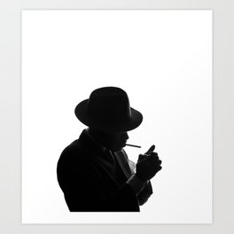 Silhouette of private detective in old fashion hat lights a cigarette Art Print