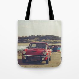 Triumph Spitfire by the sea, with ship, fine art photo, british car, sports car, color, high definit Tote Bag