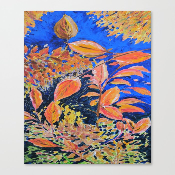 colored autumnleaves under the blue sky Canvas Print