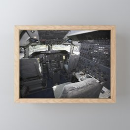 An overview of the cockpit of NASAs Shuttle Carrier Aircraft or SCA at the Shuttle Landing Facility Framed Mini Art Print