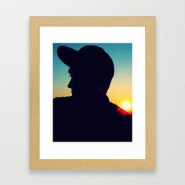 Guy in the sunset Framed Art Print