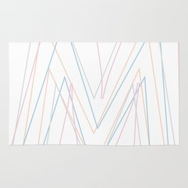 Intertwined Strength and Elegance of the Letter M Rug