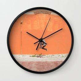 Orange jump Wall Clock