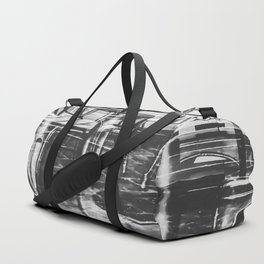 outdoor chairs in the city in black and white Duffle Bag