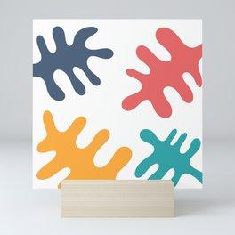 Four colored leaves Mini Art Print