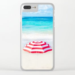 Beach umbrella by the ocean in sunny day Clear iPhone Case