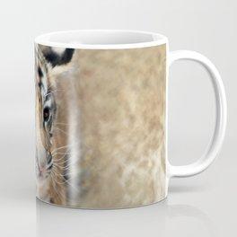 Tiger cub emerging Coffee Mug