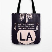 los angeles Tote Bags featuring Los Angeles by T-Shirt Business