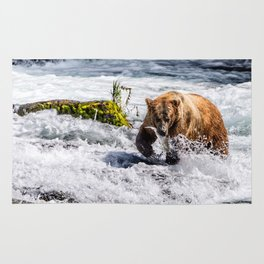 Large Brown bear in Alaska catching salmon in rapids Rug