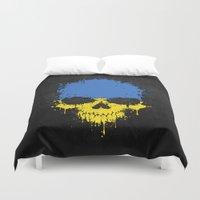 ukraine Duvet Covers featuring Flag of Ukraine on a Chaotic Splatter Skull by Jeff Bartels
