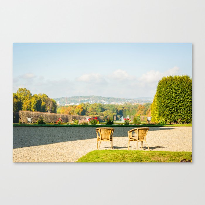 A couple of chairs on the top of a lookout watching the landscape I Canvas Print