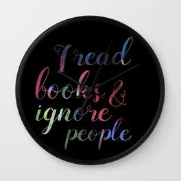 Reading books, ignoring people Wall Clock