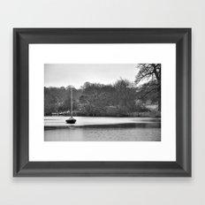 Lone boat Framed Art Print