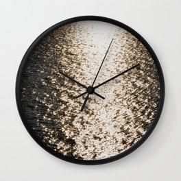 the sea at sunset Wall Clock