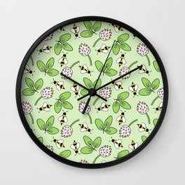 Doodle bees and clovers pattern on a green background Wall Clock