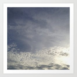 with clouds the sun sets Art Print