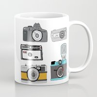 cameras Mugs featuring Cameras by Josh Ross