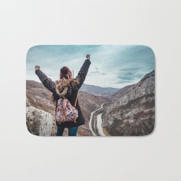 Tourist on the peak of high rocks. Big canyon on Balkan peninsula Bath Mat