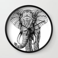 orange pattern Wall Clocks featuring Ornate Elephant by BIOWORKZ