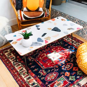 terrazzo patterned coffee table on a rug