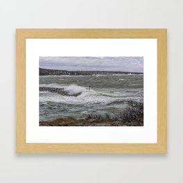 Waves crashing over the jetty Framed Art Print