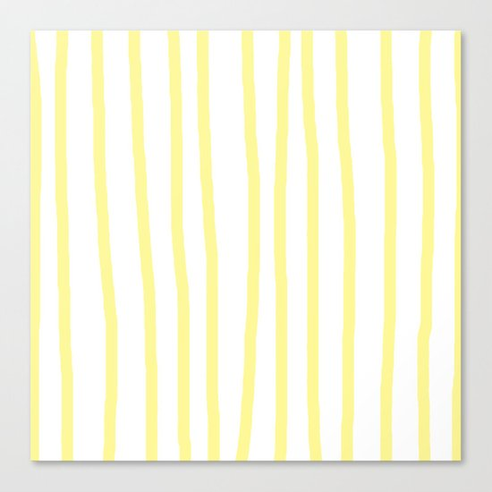 Simply Drawn Vertical Stripes in Pastel Yellow Canvas Print