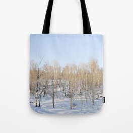 Snowfall and treetops Tote Bag