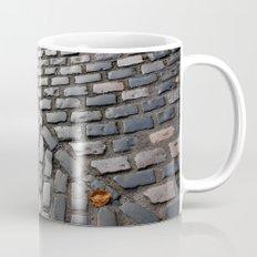 Leaves on cobblestones Mug