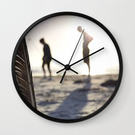 Feather on the Beach Wall Clock