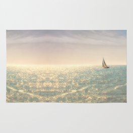 Misty summer day on the sea- a lonely boat Rug