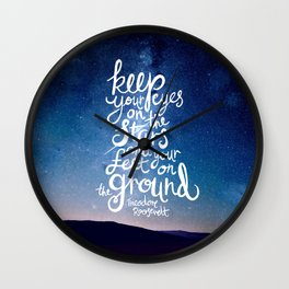 Eyes on the stars quote white lettering Wall Clock
