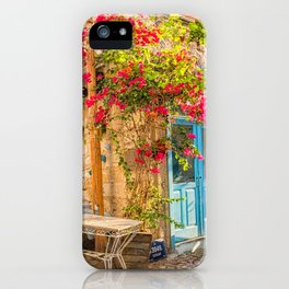 Bougainvillaea growing up the wall of a restaurant in Alacati, Izmir, Turkey iPhone Case