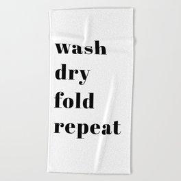 wash fold dry repeat Beach Towel