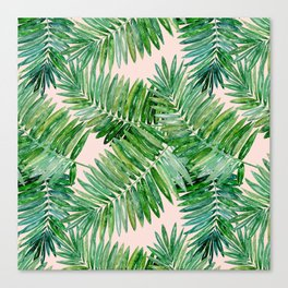 Green palm leaves on a light pink background. Canvas Print