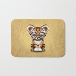 Cute Baby Tiger Cub Wearing Eye Glasses on Yellow Bath Mat