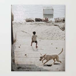 A boy and a dog Canvas Print