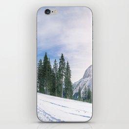 Alpine road through the snow iPhone Skin