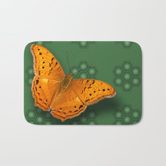 Beautiful orange butterfly on green pattern background Bath Mat