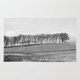 Trees on the horizon of a hill. Derbyshire, UK. Rug