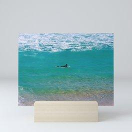 Surfer paddling to the surf at Bronte Beach. Sydney. Australia. Mini Art Print