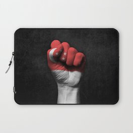 Singapore Flag on a Raised Clenched Fist Laptop Sleeve