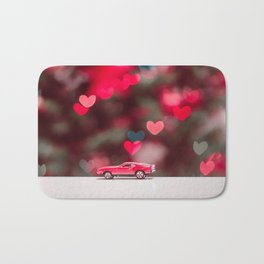 red car on the table at the love background Bath Mat