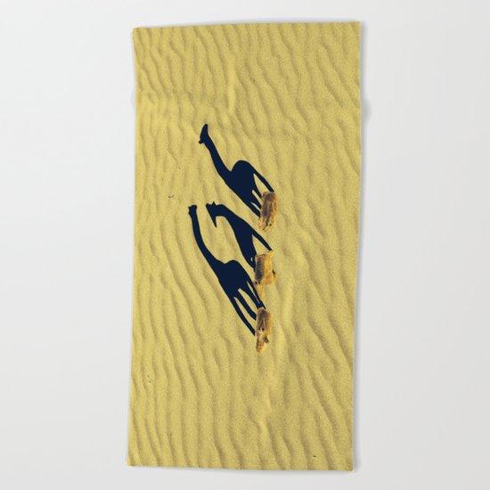 Extended long giraffes' shadows Beach Towel