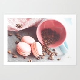 Sweet cakes with coffeebeans in a cup Art Print