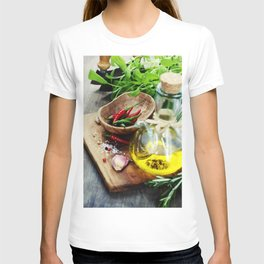 fresh  herbs  with  mezzaluna, olive oil and vegetables on cutting board T-shirt