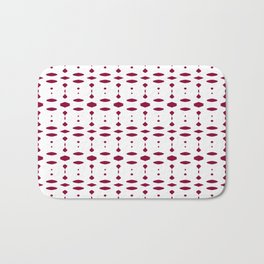 Red Christmas Ornaments on White Bath Mat